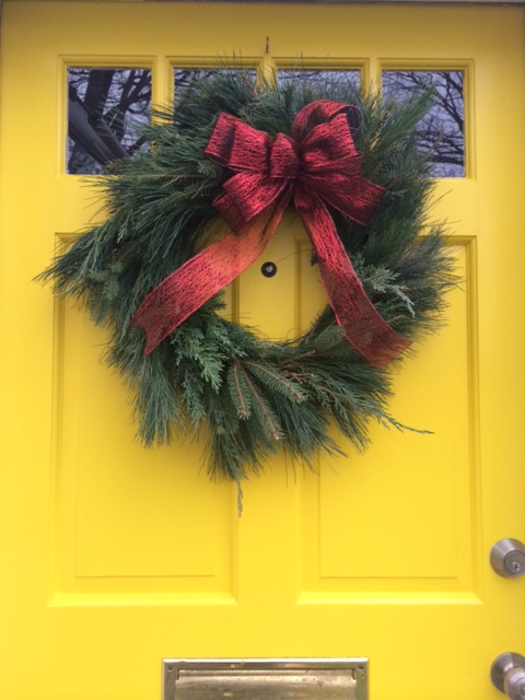 My wreath resides on my very yellow front door.