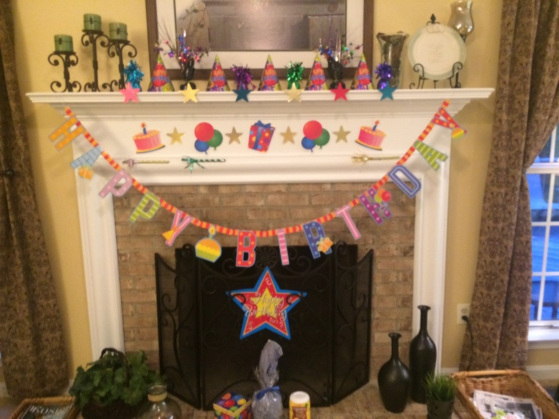 After dinner, we headed over to my parents for cake. My mom decorated the mantle in the family room.