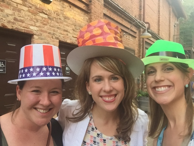 Staff wearing the funny hats at the First-Timers Reception.