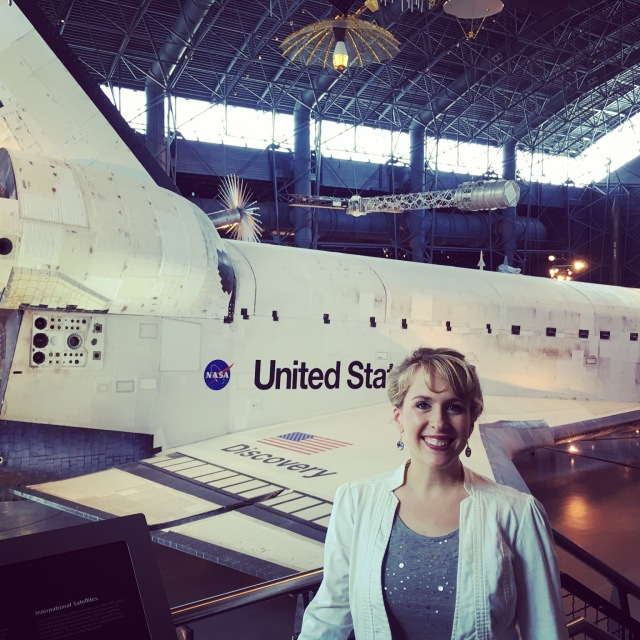 In front of the Discovery space shuttle.